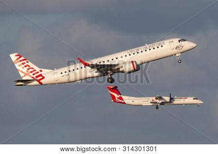 Sydney, Australia - October 7, 2013: Virgin Australia Airlines Embraer E-190 Aircraft Taking Off Fro