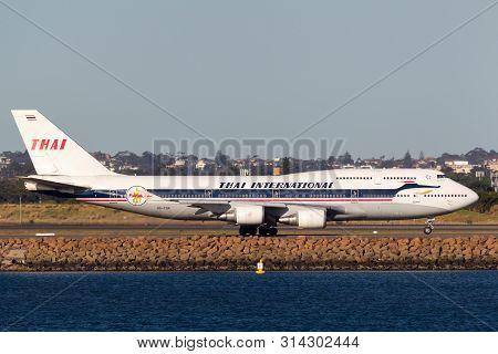 Sydney, Australia - October 9, 2013: Thai Airways International Boeing 747 Jumbo Jet Hs-tgp In Retro