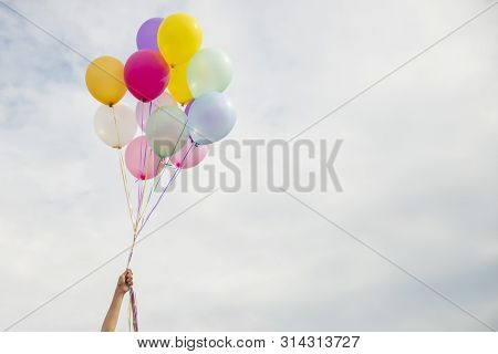 Let It Go,freedom Hand And Release Concept.birthday Balloon Holding By Happy Beautiful Women In Summ