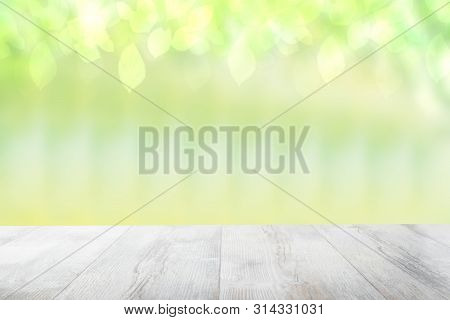 Empty Table Top Summer Background. Empty Rustic Wooden Bright Table Top In Front Of A Beautiful Abst