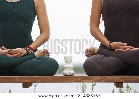 Two Women Doing Yoga Outdoors. Yoga Instructor Shows Poses. Portrait. Close-up.
