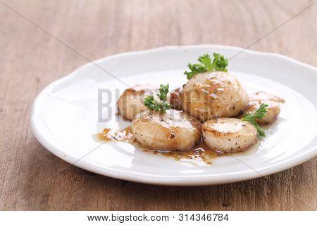 Seared Scallops On A Plate In Closeup