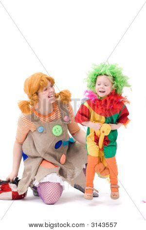 Big And Little Clown Are Playing