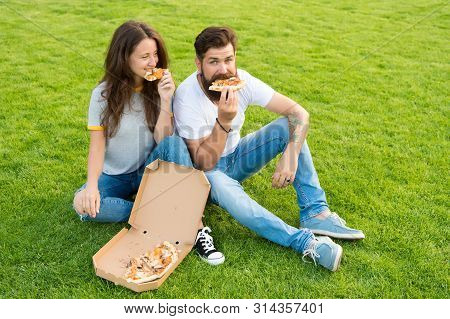 Fast Food. Bearded Man And Woman Enjoy Cheesy Pizza. Couple In Love Dating Outdoors With Pizza. Hung