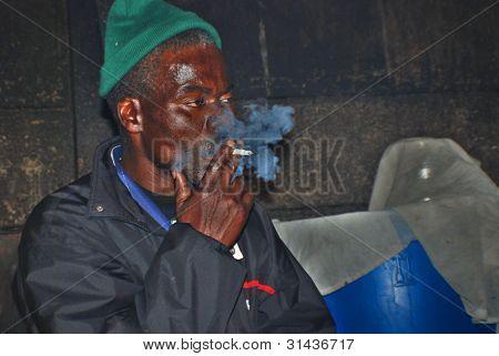 A unidentified man smoke