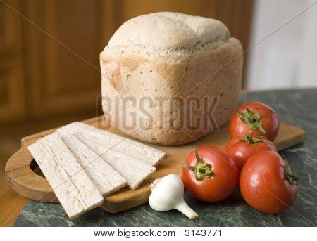 Bread On A Breadbord With Tomato