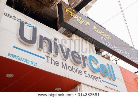 Bengaluru, India June 27, 2019 : Front View Bill Board Of Univercell Mobiles At Bengaluru.