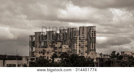 Heavy Stormy Rain Clouds Up Above Highrise. Early Monsoon Rainy Day City. Storms And Dark Monsoons T