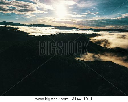 Foggy Mountains And Beautiful Sunrise In Da Lat