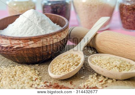 Assortment Of Different Rice In Bowls: White Rice Red Rice Black Rice A Mixture Of Wild And Brown Ri