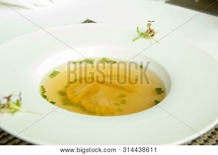 A Delicious Clear Soup On White Bowl