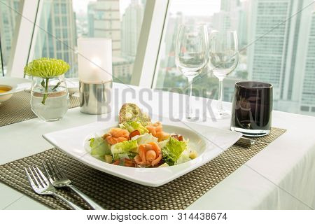 A Delicious Salmon With Vegetables Salad On Plate