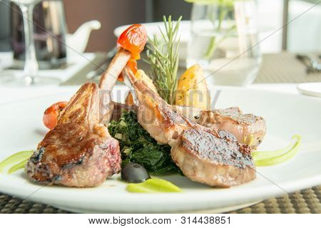A Delicious Lamb Steak With Spinash Background;