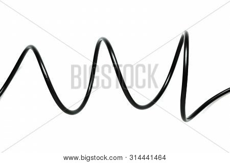 A Black Wire Cable Isolated On A White Background Abstraction.