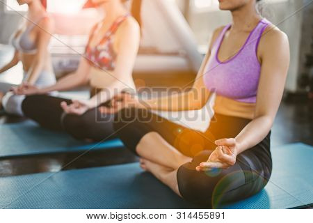 Group Of Young Asian Women Sporty Attractive People Practicing Yoga Lesson With Instructor, Standing
