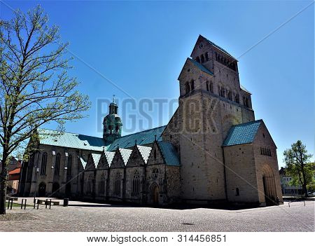The Massive Hildesheim Cathedral In Front Of Blue Sky