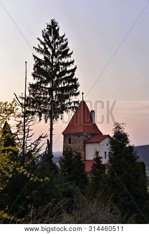 Sighisoara, Transylvania; House With Typical Tower , Sunset