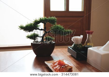 Set Of Flavoring Japanese Foodand Plastic Bonsai With Window Light Background