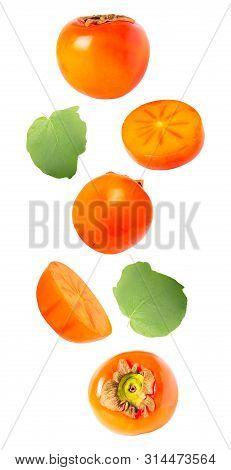 Levitation Khaki Fruits With Leaves Isolated On White Background
