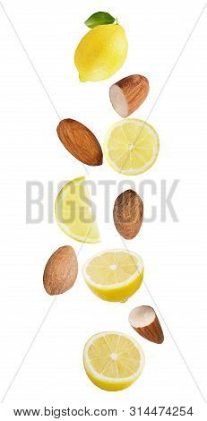 Floating Isolated On White Background Lemon Fruits And Almonds