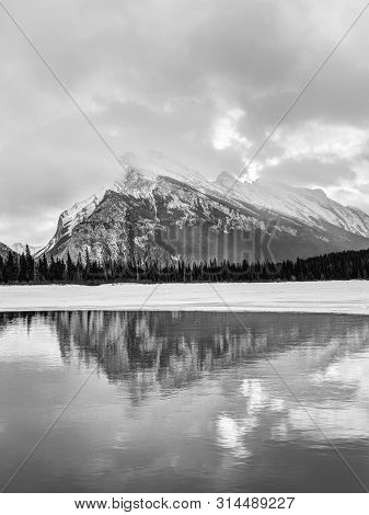 Black And White Rendering Of Vermilion Lakes During Winter In The Canadian Rockies Of Banff National