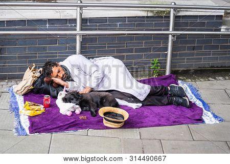 London, Uk, July, 2019. Poor Homeless Man Or Refugee Sleeping On The Urban Street In The City, Socia
