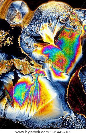 Acid crystals in molten sugar