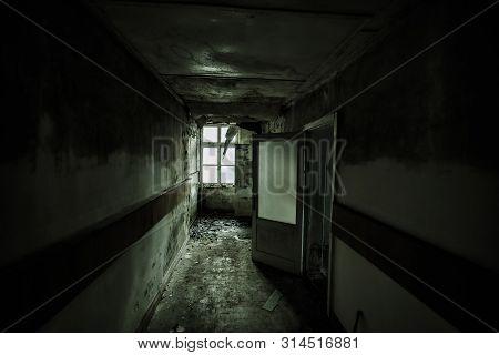 Dark And Creepy Corridor Of Abandoned Building (hospital, School, Dorm, Etc.)