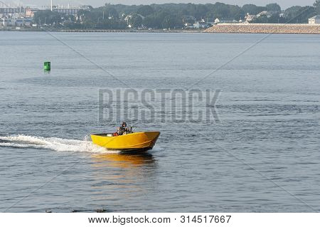 Fairhaven, Massachusetts, Usa - July 30, 2019: Man Driving Colorful Skiff Across New Bedford Outer H