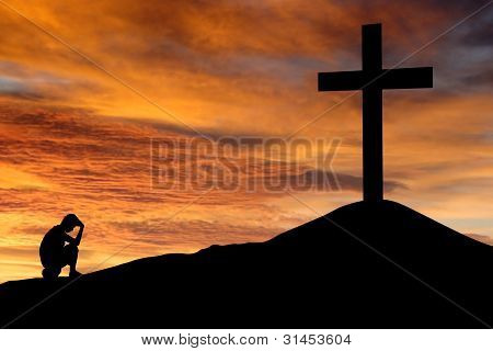 Christian Background - Silhouette Of A Man Sitting Regretting His Sins