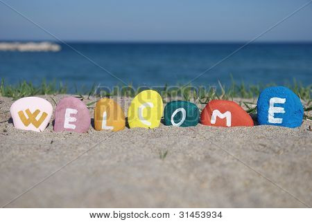 welcome concept on colourful pebbles