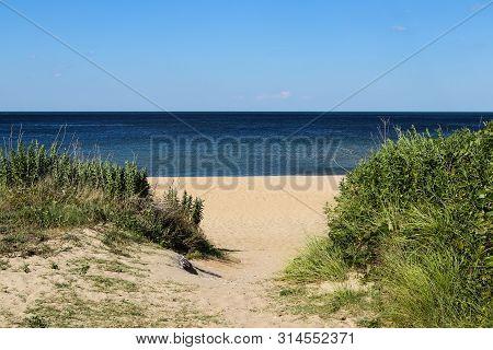 Path To Beach Facing Chesapeake Bay At Ocean View Beach In Norfolk, Virginia.