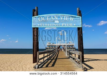 Norfolk, Virginia/usa - July 22, 2019:  Entrance Sign For The Ocean View Fishing Pier, With The Rest