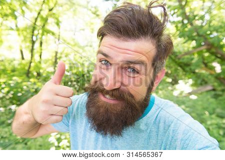 Perfect Hair Length For His Face Shape. Happy Man With Styled Hair Giving Like Hand. Hairy Guy With