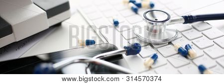 Stethoscope And Pharmaceutical Pill Lying Keyboard. Assorted Medicine Pill For Medication Treatment.