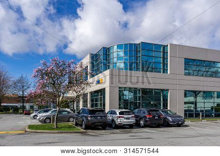 Richmond, Canada - March 26, 2019: Modern Business Building With Offices Parking Lot And Cars.