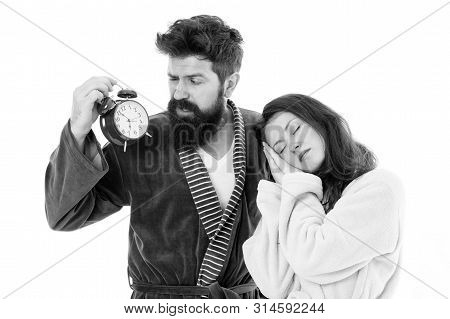 An Early Morning Hour. Sleepy Woman And Bearded Man Holding Alarm Clock Early In The Morning. Sexy G