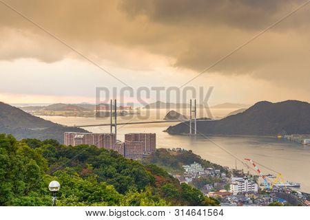Megami Bridge spans the Bay of Nagasaki, Japan at dusk.