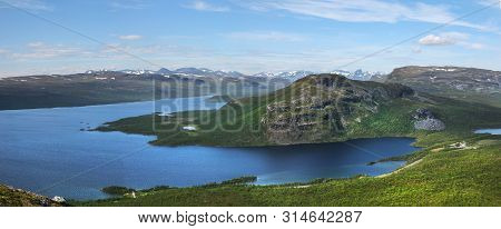 Panoramic View Of Lake Kilpisjarvi And Malla Fells, Seen From Saanatunturi Fell To North. Snowy Moun