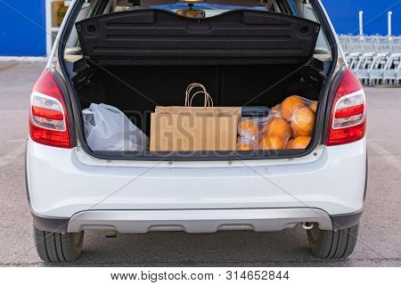 Opened Car Trunk With Bags With Food Purchased In Grocery Store