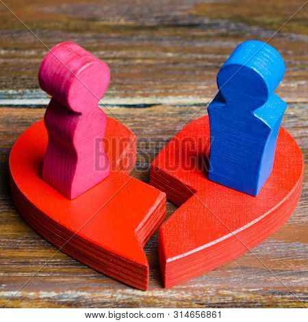 A Red Broken Heart With A Couple In Lovers. Renewal Of The Relationship. Family Psychotherapist Serv