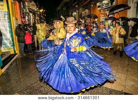 Puno, Peru - Jan 5, 2019: Authentic Colorful Carnival on the streets of Puno by night, Peru near the high altutude Titicaca lake . South America.