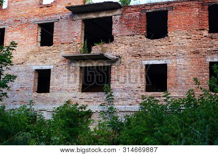 The Building Of A Supermarket On Donbass Fired And Destroyed By Heavy Armament Is A Red Brick Buildi