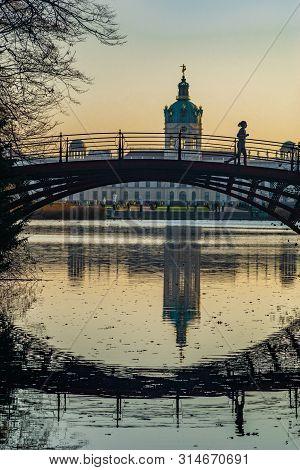 Berlin, Germany - November 16, 2018: Lake And Bridge Of Castle Charlottenburg In Berlin With Reflect