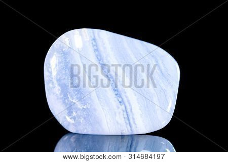 Trumbled Blue Chalcedony Mineral Stone In Front Of Black Background, Mineralogy And Esotericism