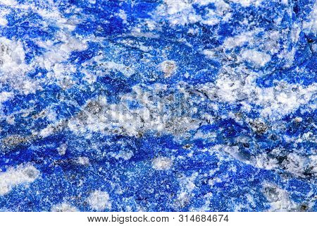 Closeup Of Lapis Lazuli Mineral Stone, Pattern Background With Details Of Mineralogy