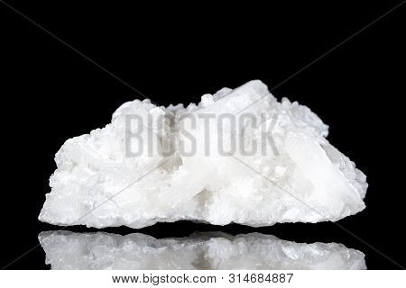 Raw White Stilbite Or Desmine Mineral Stone In Front Of Black Background, Mineralogy And Esotericism