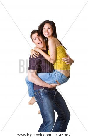 Loving Couple In Denim Play During Their Photo Shoot
