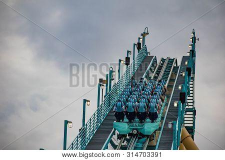 Orlando, Florida. July 25, 2019. Top View Of People Enjoying Kraken Rollercoaster At Seaworld 6