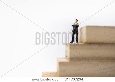 Business, Planning, Succession And Management Concept. Close Up Of Businessman Miniature Figure Stan